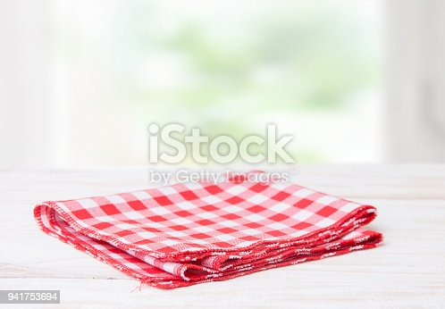 istock Red tablecloth in a cage on a wooden table 941753694