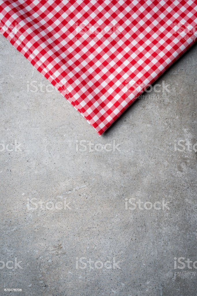 Red tablecloth on gray stone table stock photo