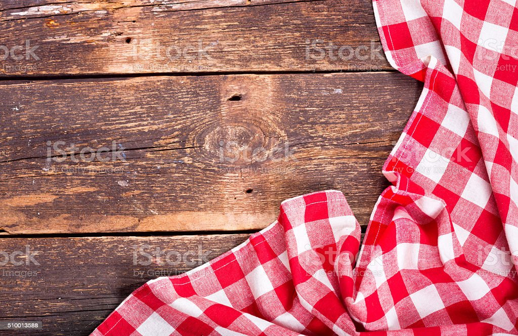 red tablecloth on rustic wooden table stock photo