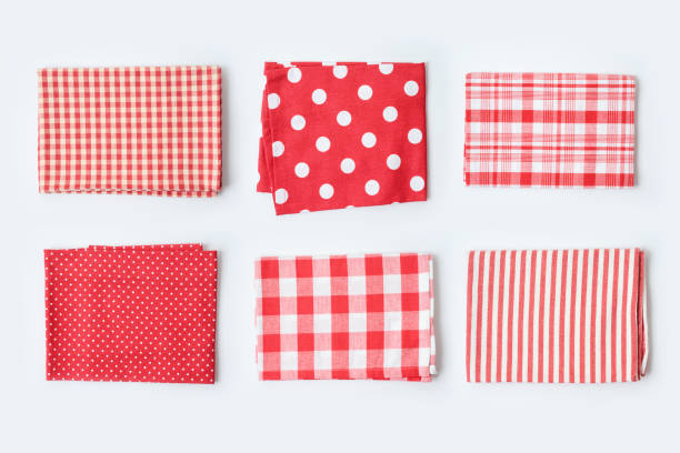 Red tablecloth or kitchen towel collection on white background. Cooking or baking mock up for design. stock photo