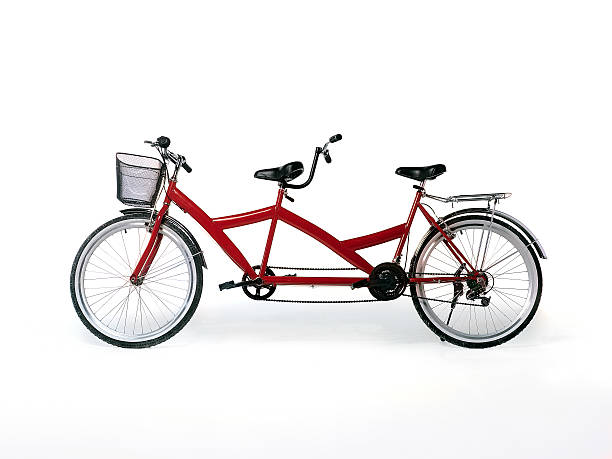 red tandem bicycle - symmetry stock pictures, royalty-free photos & images