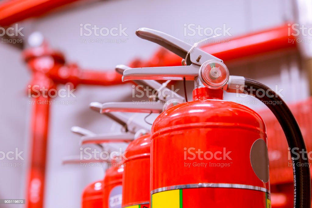 Red tank of fire extinguisher Overview of a powerful industrial fire extinguishing system. stock photo