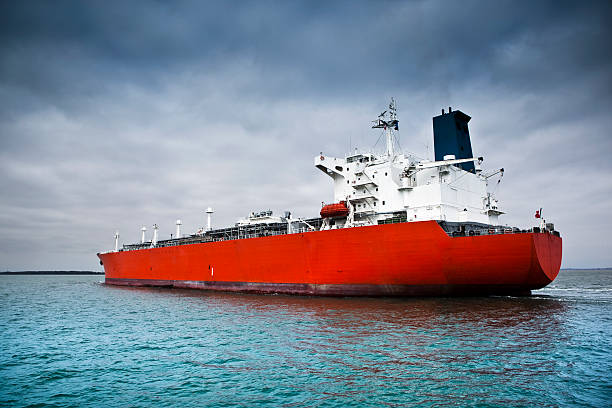 Red tanker ship afloat in the ocean stock photo