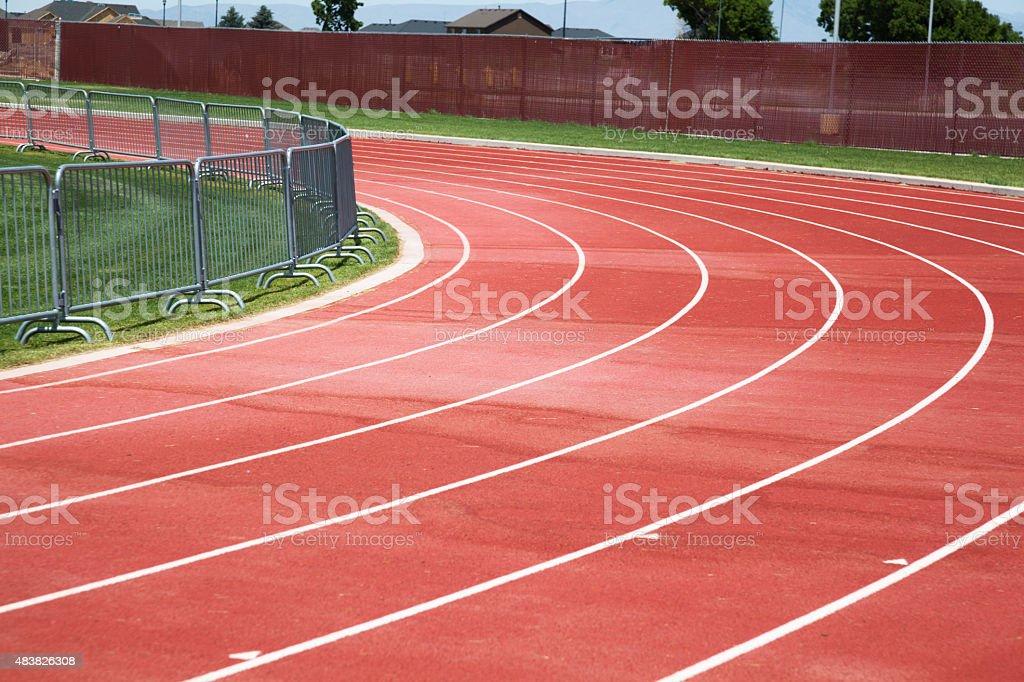 red tarmac running athletics track lanes stock photo