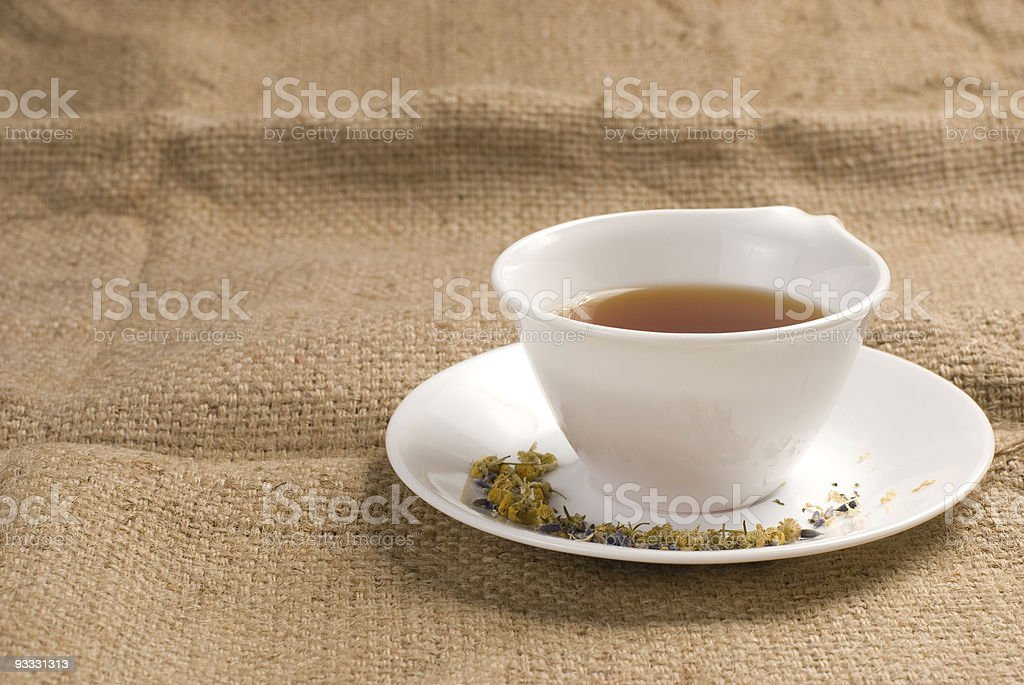 Red tea in ceramic cup with burlap background royalty-free stock photo