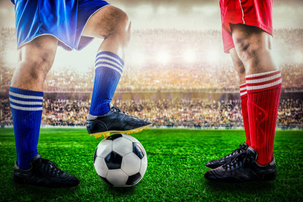 red team versus blue team in the stadium of soccer football - soccer competition stock photos and pictures