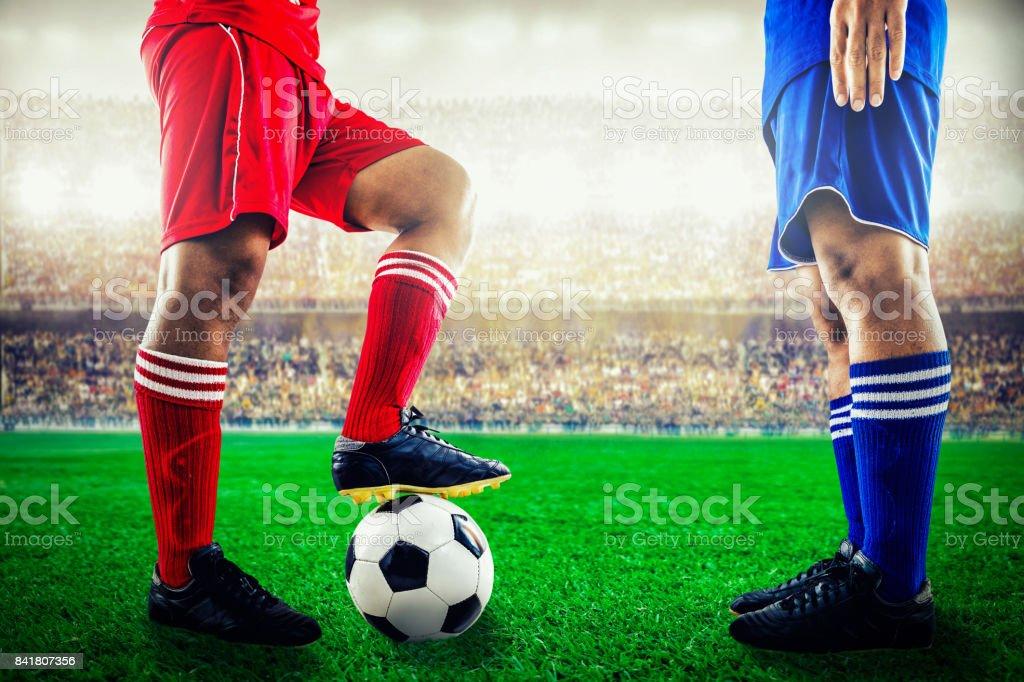 red team versus blue team in the stadium of soccer football stock photo