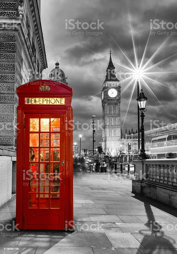 Red telephone booth in front of the Big Ben stock photo