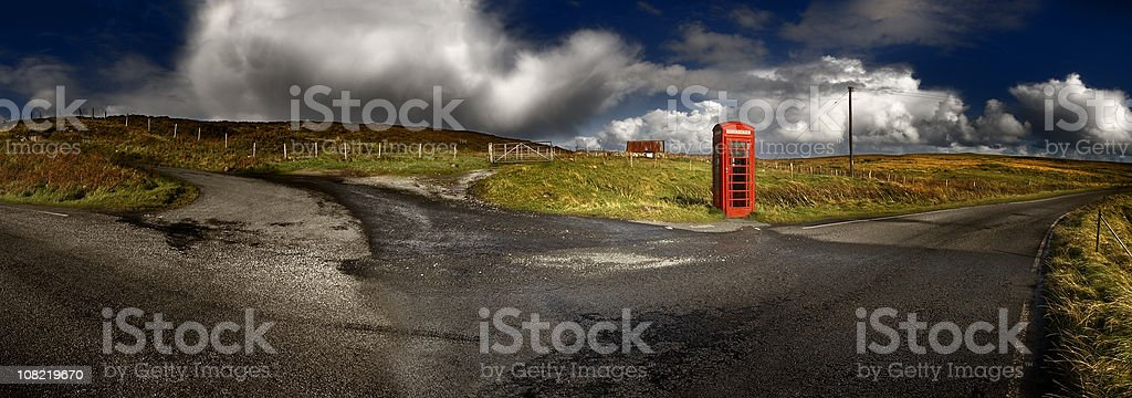 Red telephone booth rural landscape royalty-free stock photo