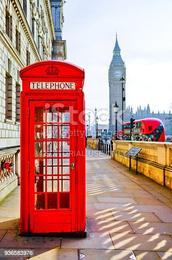 London, UK- February 6 : Red telephone box and Big Ben  in London on a sunny day on February 6, 2017.