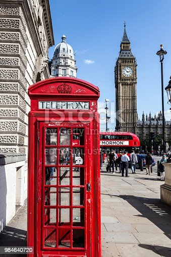 London, England - September 6, 2015: Traditional red british phone booth in front of Big Ben.