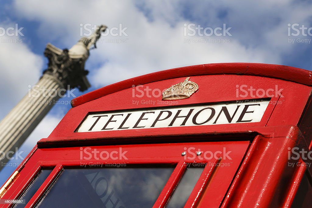 Red Telephone Box and Nelson's Column stock photo