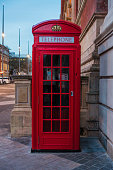 Red telephone box on a street in London, England, United Kingdom