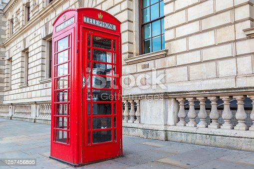 Red telephone box (booths) in London in a beautiful summer day, London, England, United Kingdom