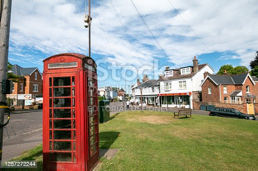 Red Telephone Box in Pembury, England, with shops and restaurants in the background