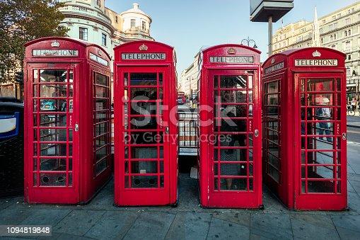 Red telephone box row in London, UK.
