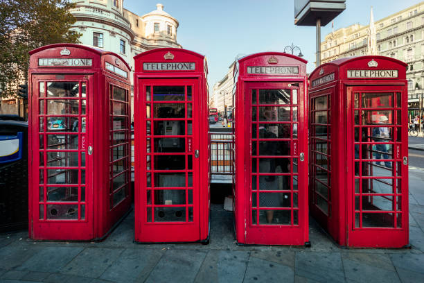 Red telephone box row in London, UK. stock photo