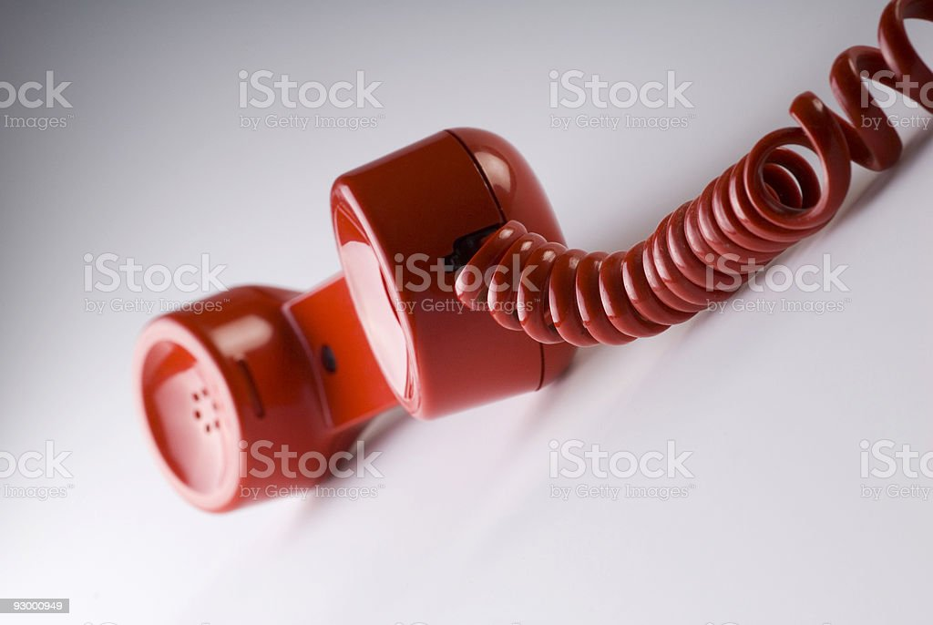Red telephone handset and cable royalty-free stock photo