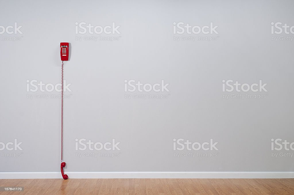 Red Telephone In Empty Room stock photo