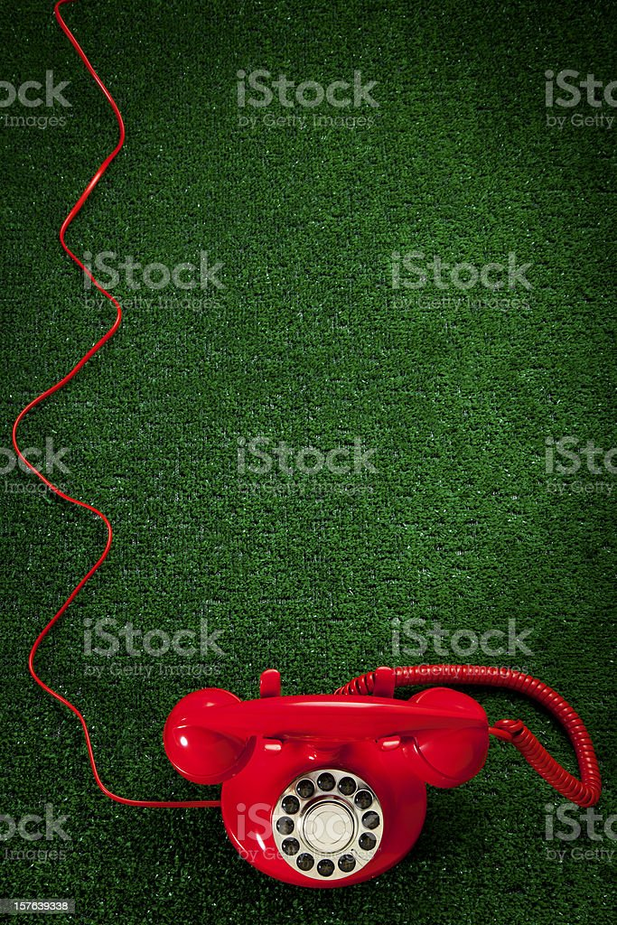 Red Telephone on Green Astro Turf royalty-free stock photo