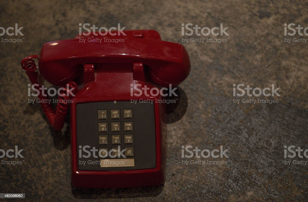 red telephone on slate background royalty-free stock photo