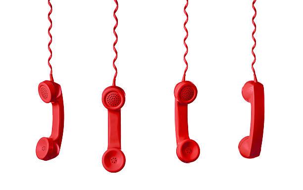 red telephone receiver isolated on a white background - cornetta telefono foto e immagini stock