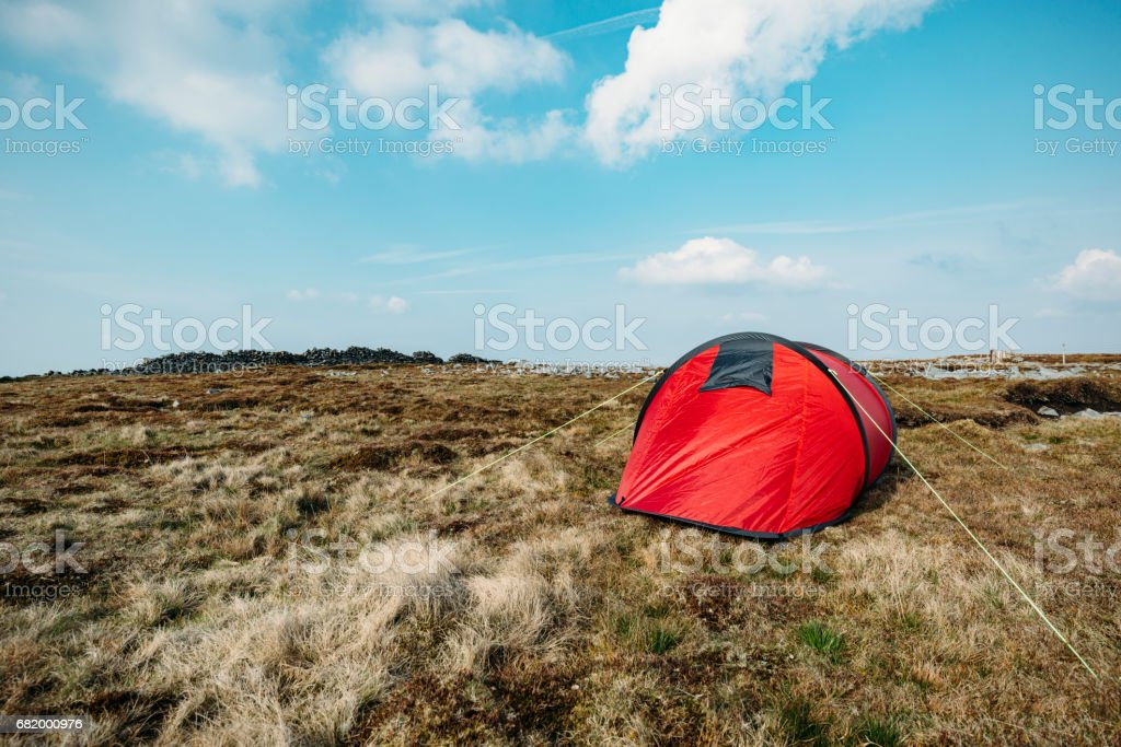Red tent in a remote location. stock photo