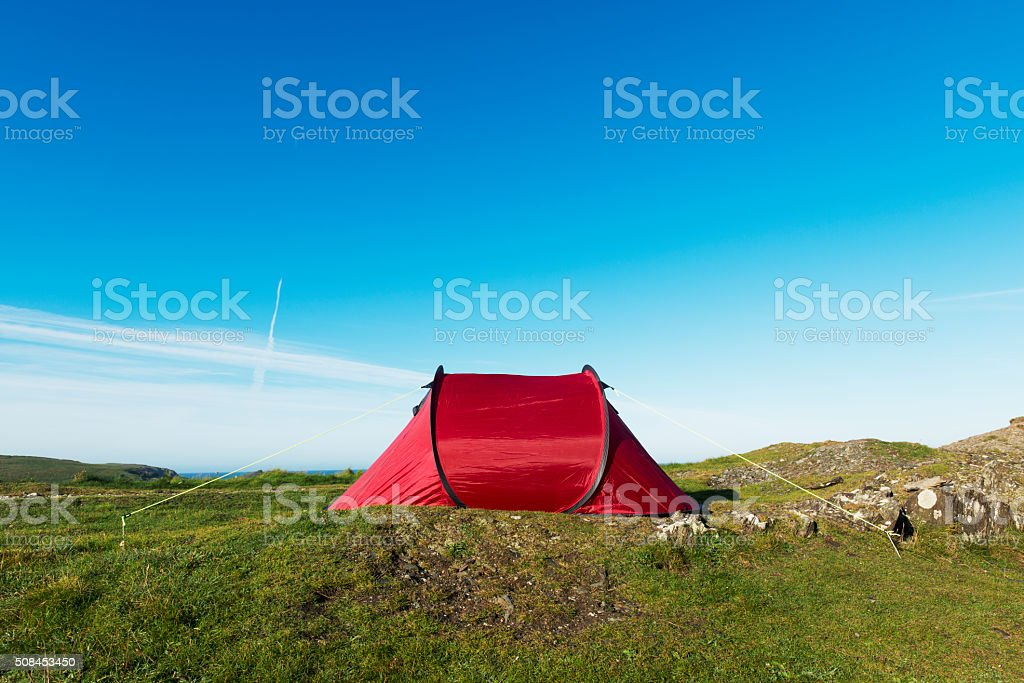 Red Tent in a remote position by the sea. stock photo