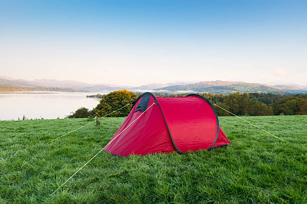 red tent over looking lake windermere - tent stock pictures, royalty-free photos & images