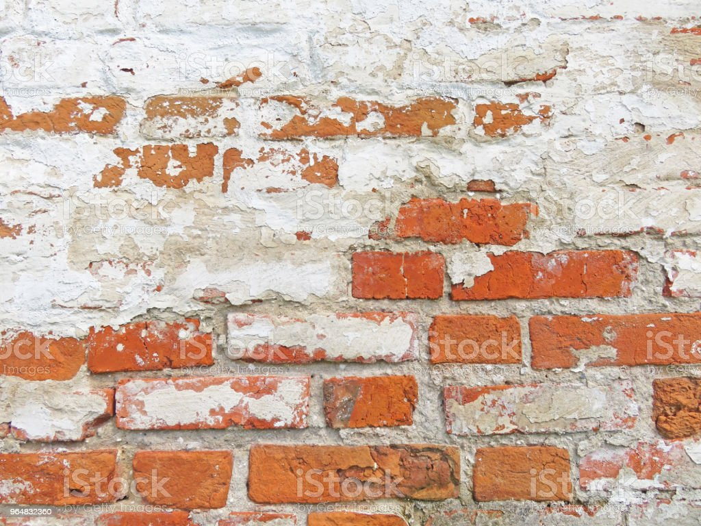 Red, Terracotta and White Brick Background. Old Wall of Red Bricks and White Brayed and Cracked Old Paint. royalty-free stock photo