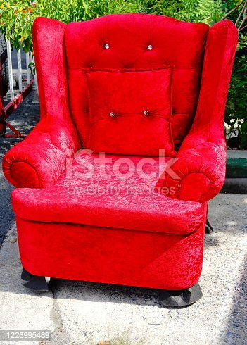 Chair decoration with red velvet fabric and Red pillow on chair.