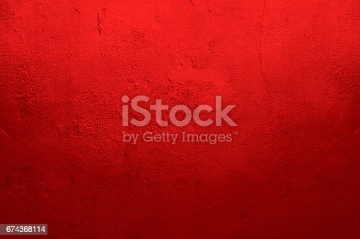 istock Red Textured Wall 674368114