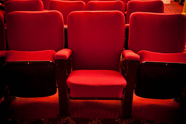 red theater event seating - seat stock photos and pictures