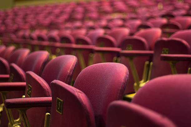 red theater seats - film festival stock photos and pictures