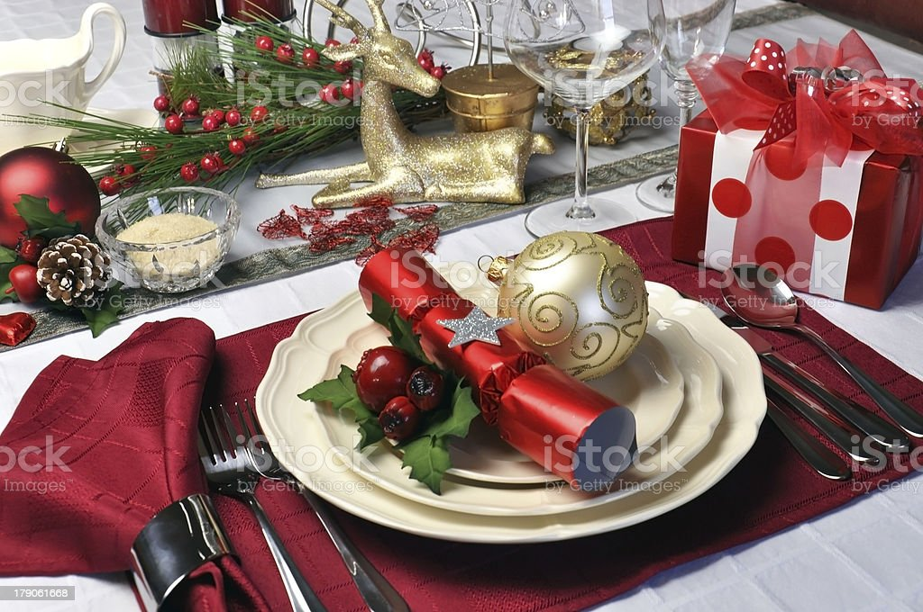 Red theme Christmas dinner table setting stock photo