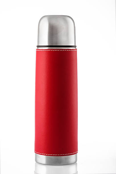 red thermos isolated on white - flask stock photos and pictures