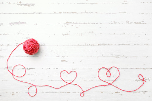 Red thread, two hearts and tangle