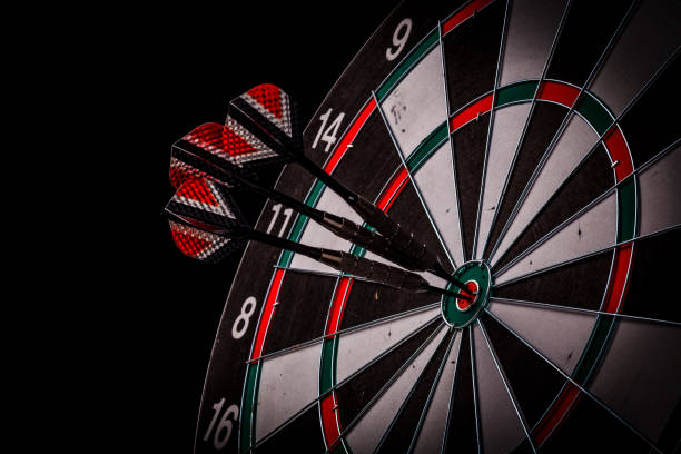 red three darts arrows in the target center stock photo