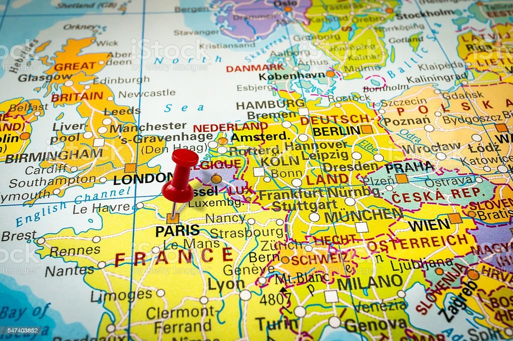 Red thumbtack in a map pushpin pointing at paris stock photo more red thumbtack in a map pushpin pointing at paris royalty free stock photo gumiabroncs Image collections