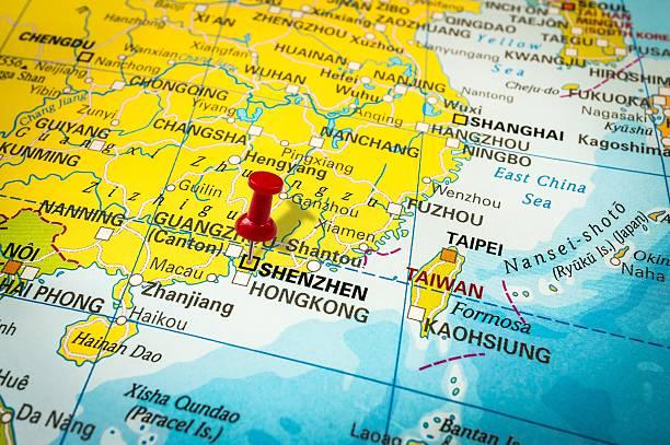 red thumbtack in a map, pushpin pointing at shenzhen - guangdong i̇li stok fotoğraflar ve resimler