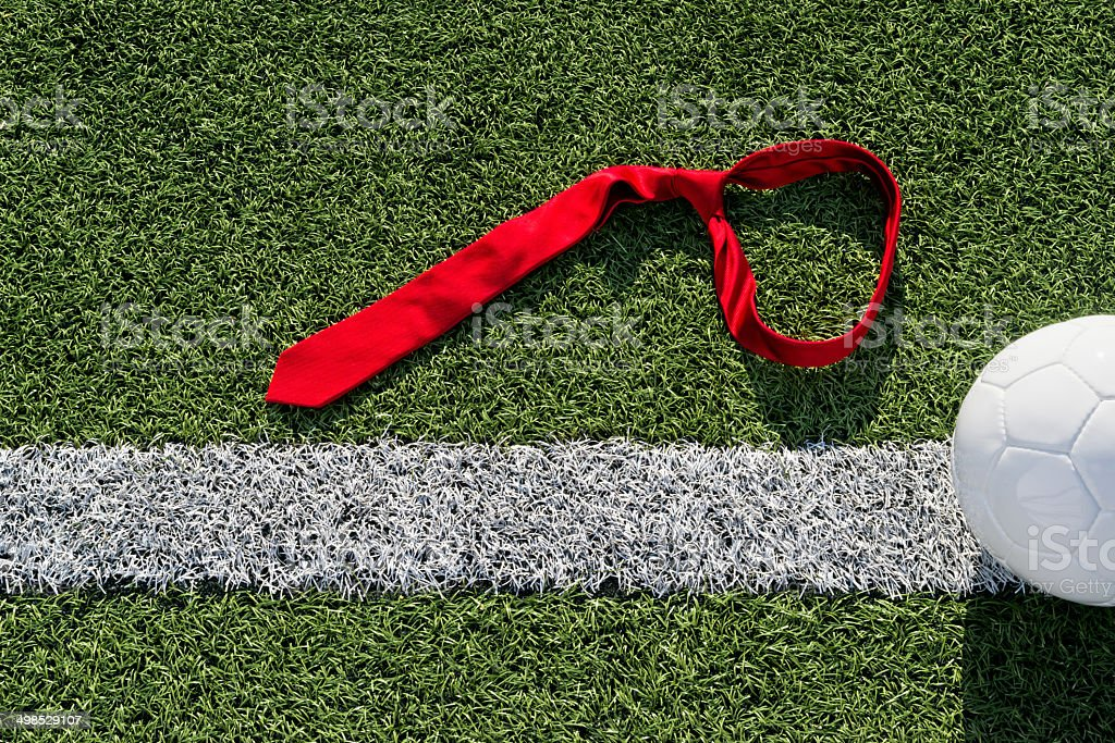 Red tie on a soccer field stock photo