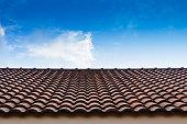 red tile roof blue sky