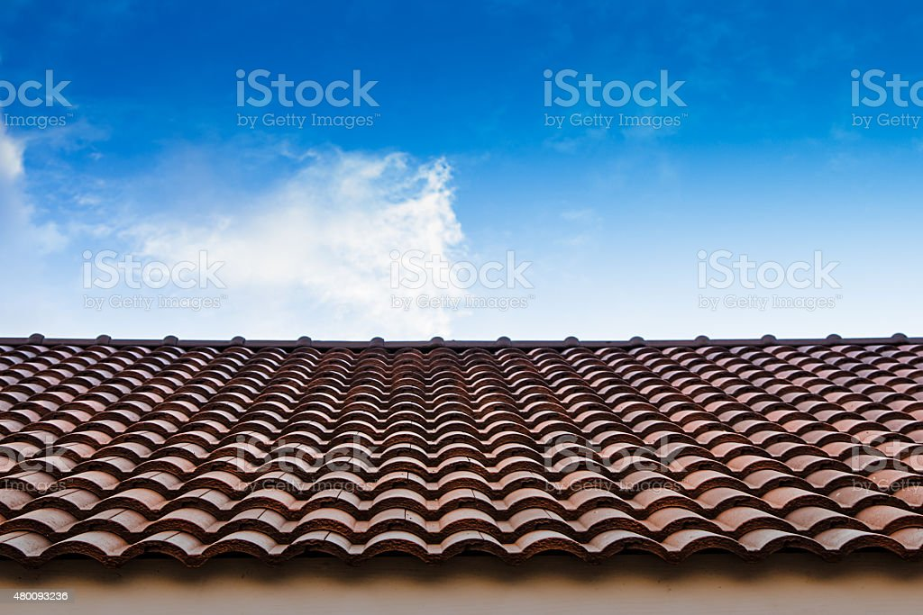 red tile roof blue sky stock photo