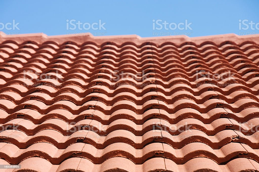 Red Tile Roof Under Blue Sky stock photo