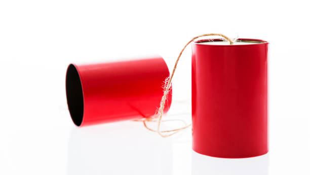 Red tin cans phone on white background stock photo