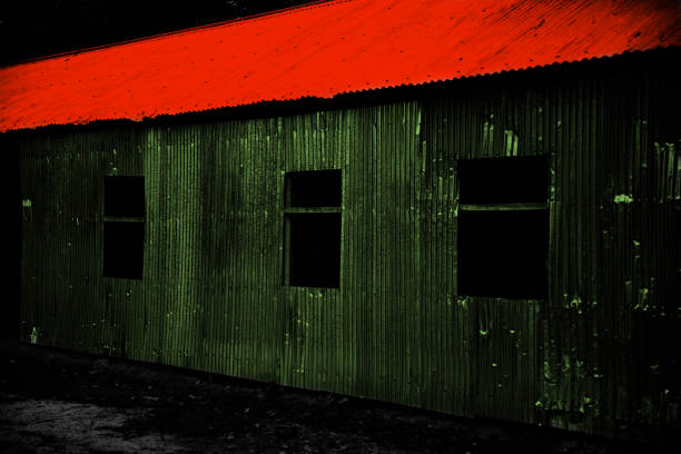 Red tin shed rooftop of a green house unique photo stock photo