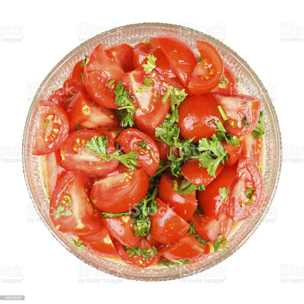 Red tomato and parsley salad in glass bowl stock photo