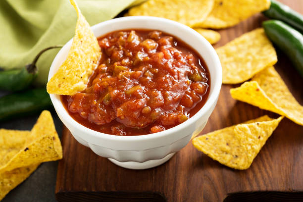 Red tomato spicy salsa with chips Red tomato spicy salsa with corn chips salsa sauce stock pictures, royalty-free photos & images