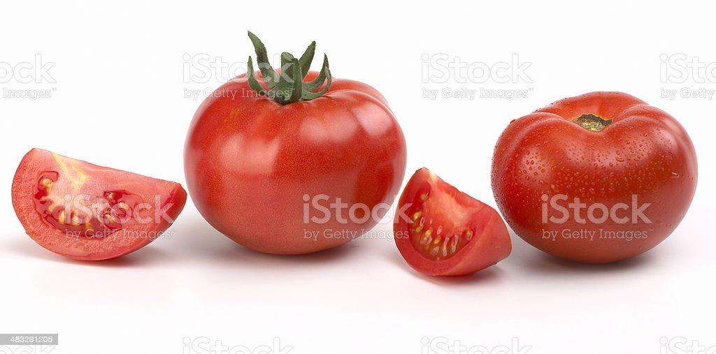 Red Tomatoes and slices stock photo