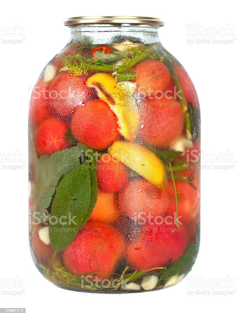 red tomatoes in a glass jar royalty-free stock photo